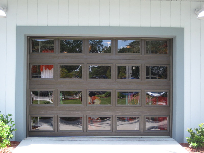 Adding Any Type Of Weight To Any Garage Door Will Require A New Spring  Calculation And Possibly Upgraded Track And Hardware.